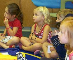 Several children sitting on the floor