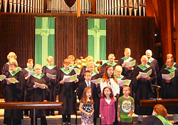 The choir singing in front of the congregation