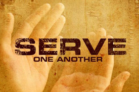 "A pair of hands open and appearing to hold the text: ""Serve One Another"""