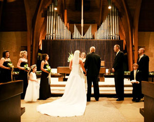 Image of a wedding taking place in the sanctuary