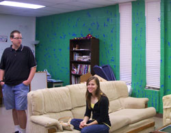 Two students hanging out in the youth room